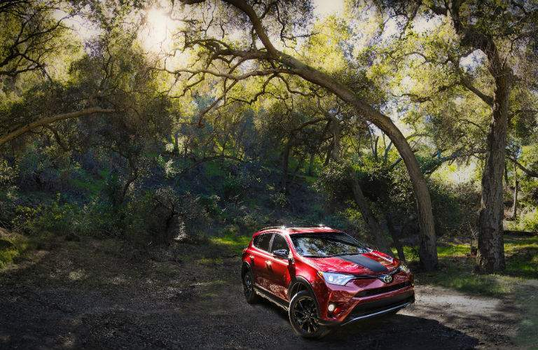 The 2018 Toyota RAV4 Adventure parked on a trail in the woods showing its new capability