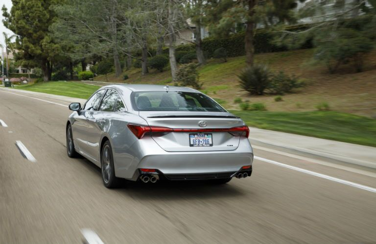 A rear photo of the 2019 Toyota Avalon in motion on the road.