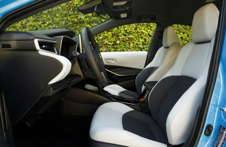 A photo of the front seats in the 2019 Toyota Corolla Hatchback.