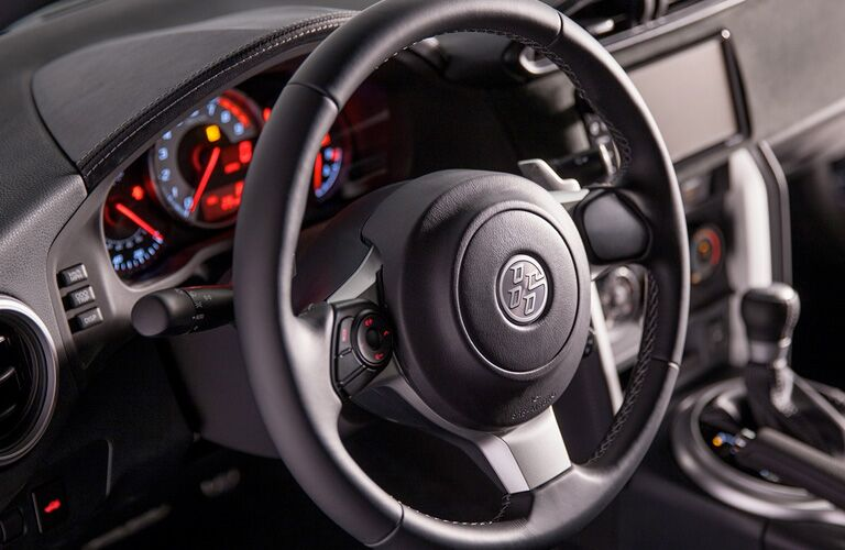 A tight photo of the steering wheel used for the 2018 Toyota 86.