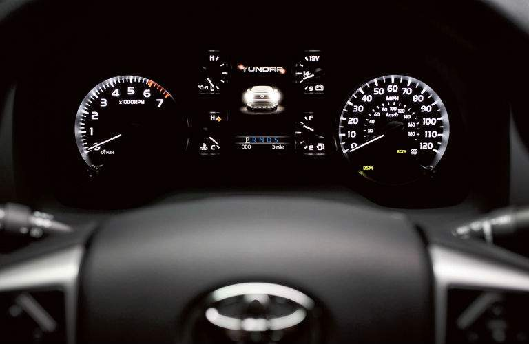 The center gauge cluster of the 2018 Tundra showing where the active safety system has its indicators