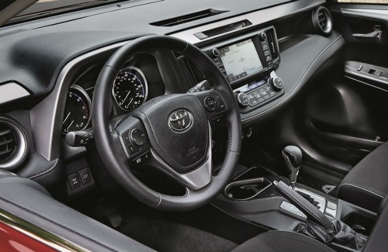 An interior photo of driver's cockpit of the 2018 Toyota RAV4.