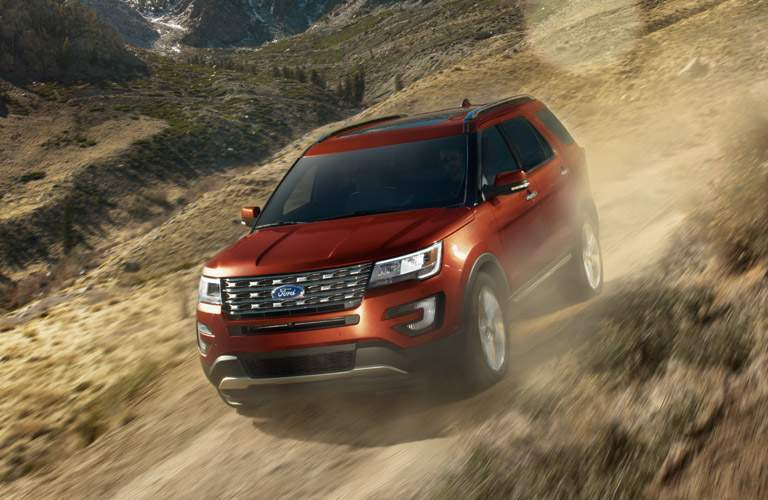 Red 2016 Ford Explorer on Mountain Trail