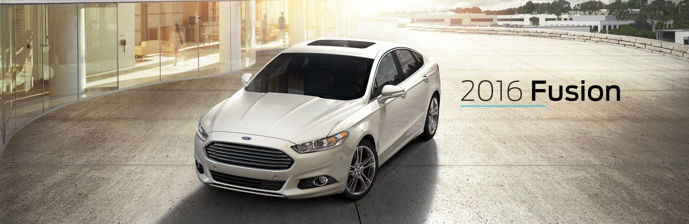 White 2016 Ford Fusion in Parking Lot with Black 2016 Fusion Text