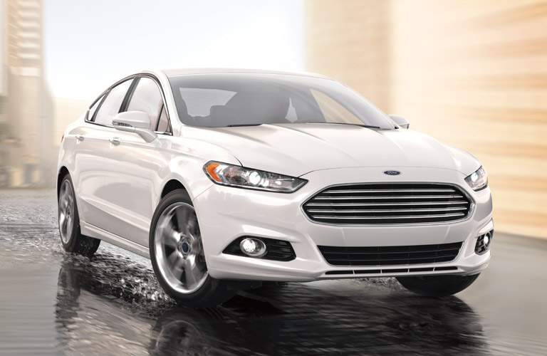 White 2016 Ford Fusion on Wet Street