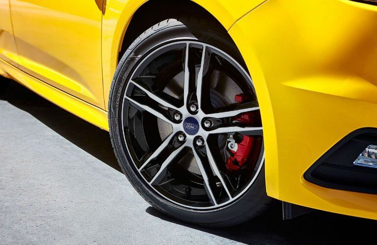 Close Up of Ford Focus ST Wheels and Tires with Red Brake Calipers