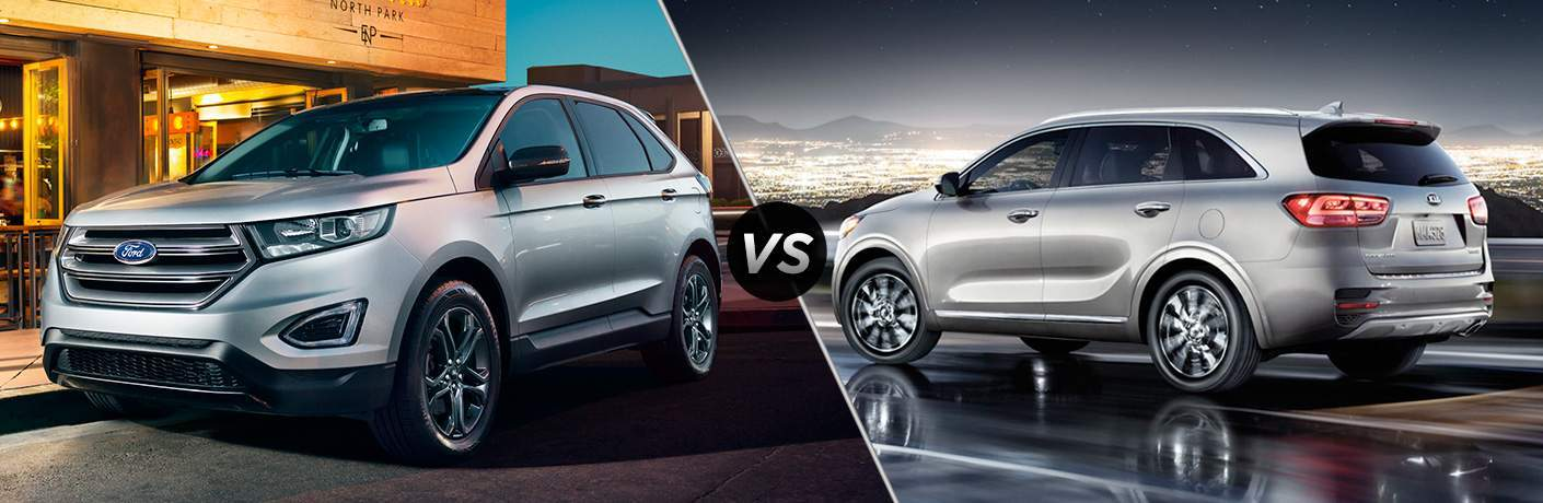 Silver  Ford Edge In Front Of Restaurant Vs Silver  Kia Sorento Overlooking City At