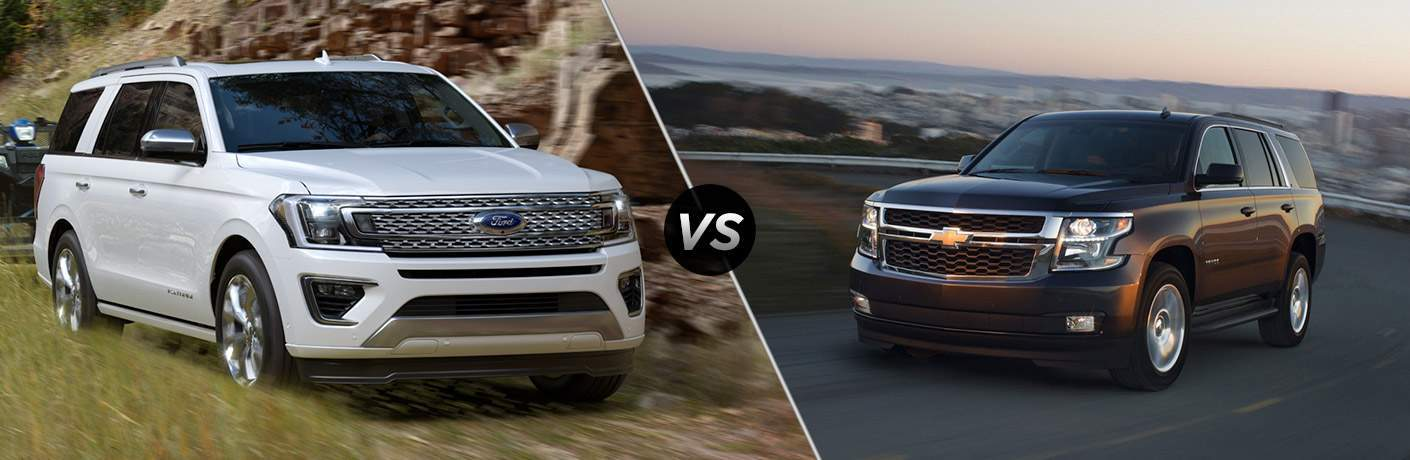 White 2018 Ford Expedition Towing Trailer on Country Road vs Black 2018 Chevy Tahoe on Highway