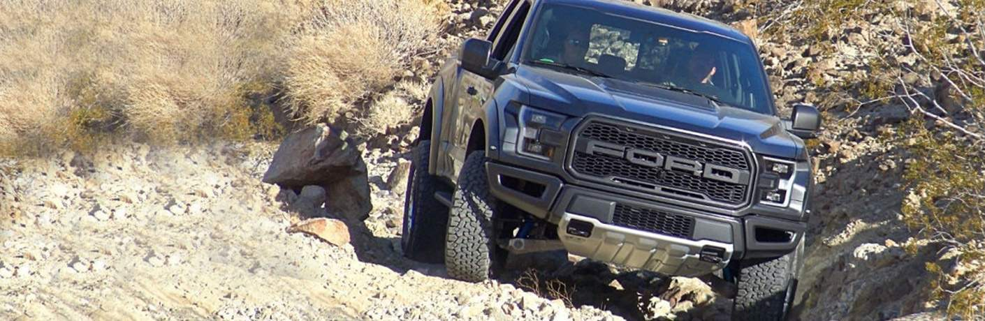 Black 2018 Ford F-150 Raptor on Rocky Incline