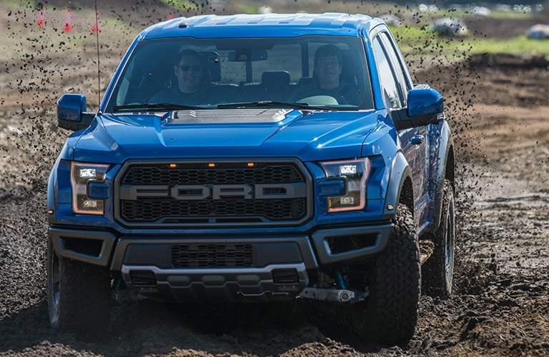 Blue 2018 Ford F-150 Raptor Front Exterior Driving in Mud