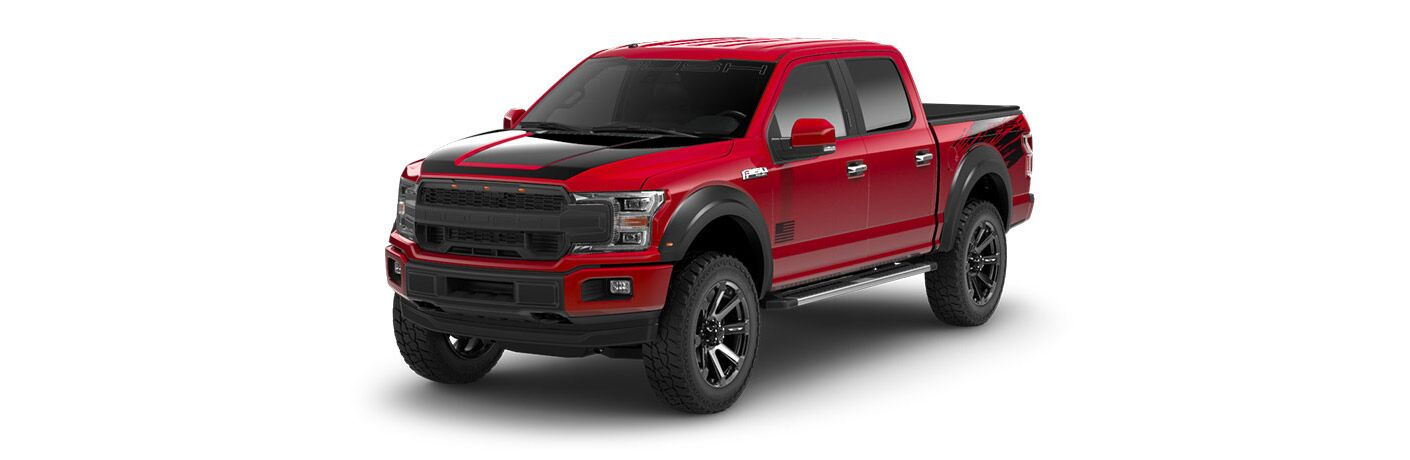 Red and Black 2018 Ford F-150 ROUSH Model on a White Background