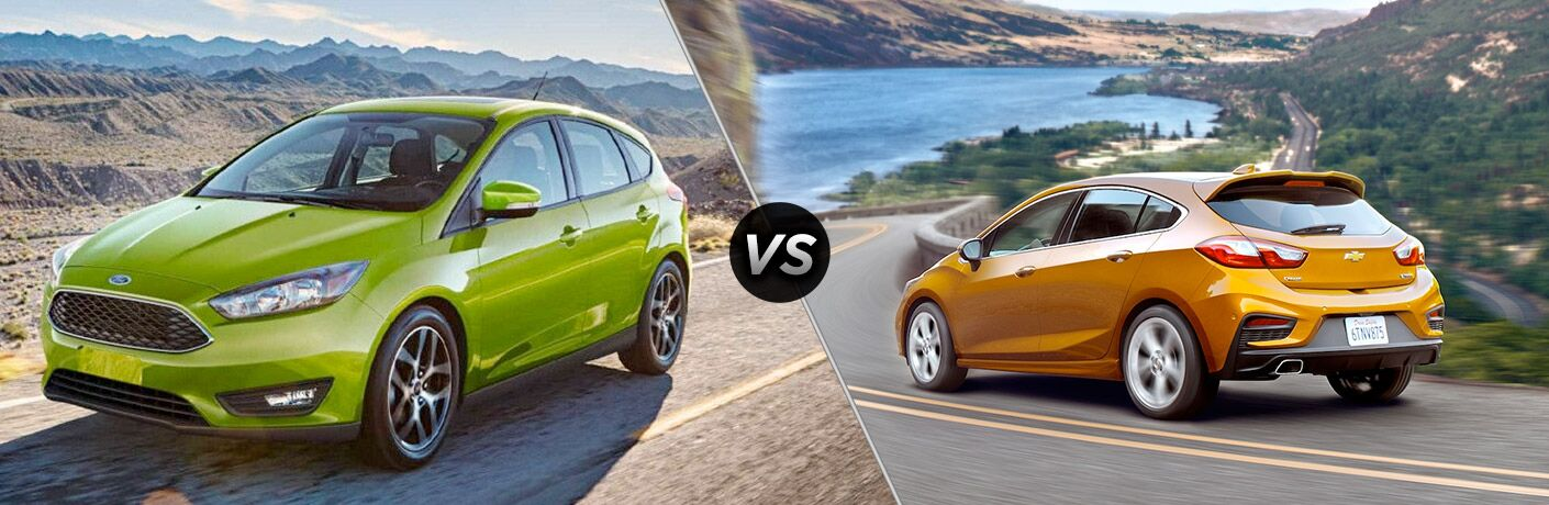 Green 2018 Ford Focus Hatchback on a Dirt Road vs Orange 2018 Chevy Cruze Hatchback on a Coast Road