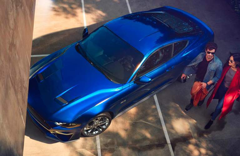Overhead View of 2018 Ford Mustang Coupe with Couple Next to Driver's Side