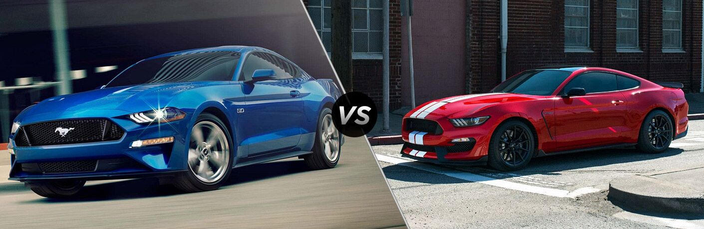 Blue 2018 Ford Mustang GT on a City Street vs Red 2018 Ford Mustang Shelby GT350 with White Stripes on a City Street