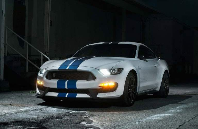 White 2018 Ford Mustang Shelby GT350® with Blue Pinstripes in Dark Alley with Lights On
