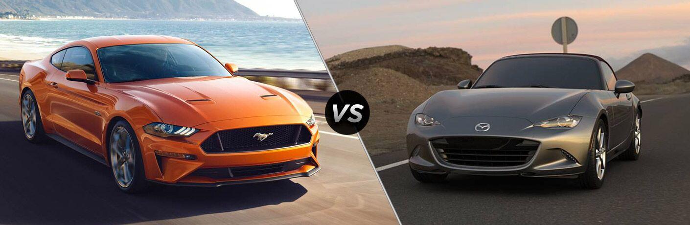 Orange 2018 Ford Mustang on a Coast Road vs Gray 2018 Mazda MX-5 Miata on a Country Road