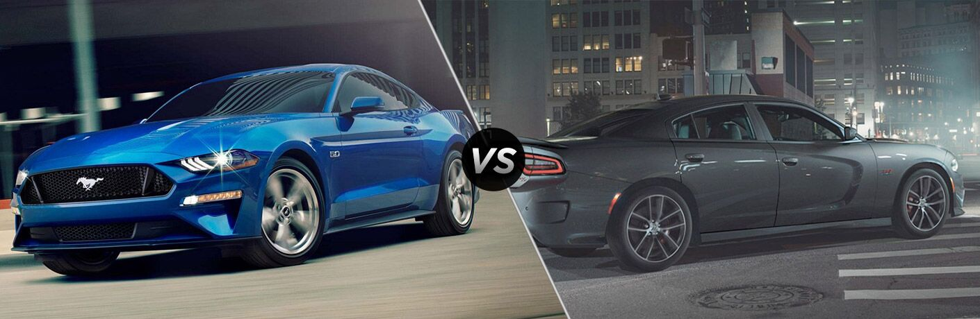 Blue 2018 Ford Mustang on City Street vs Black 2018 Dodge Charger on City Street at Night