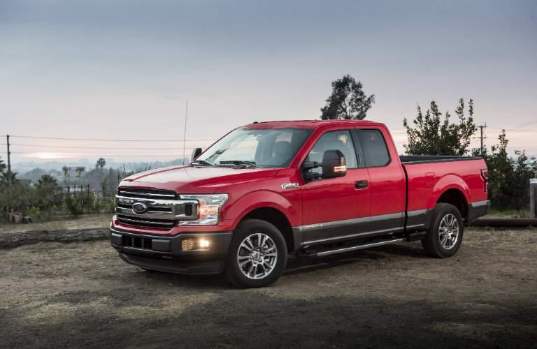 Red 2018 Ford F-150 Power Stroke Diesel in Parking Lot