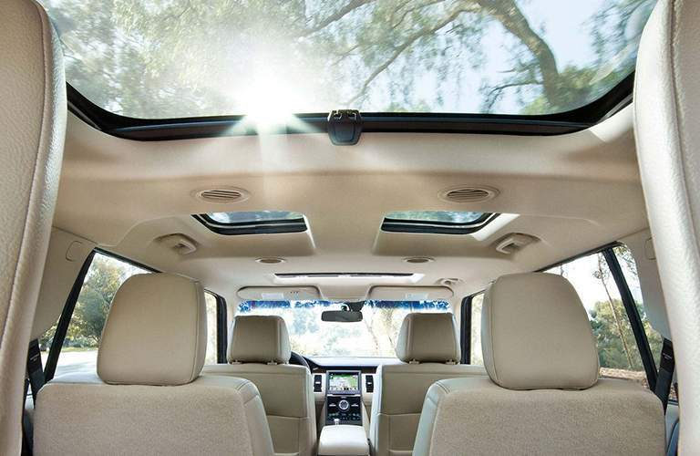 2018 Ford Flex interior with beige cloth and open sunroof