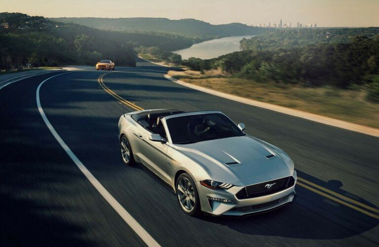 Silver 2018 Ford Mustang Convertible on a Highway