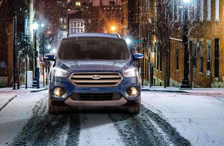 Blue 2019 Ford Escape on a City Street in Snow