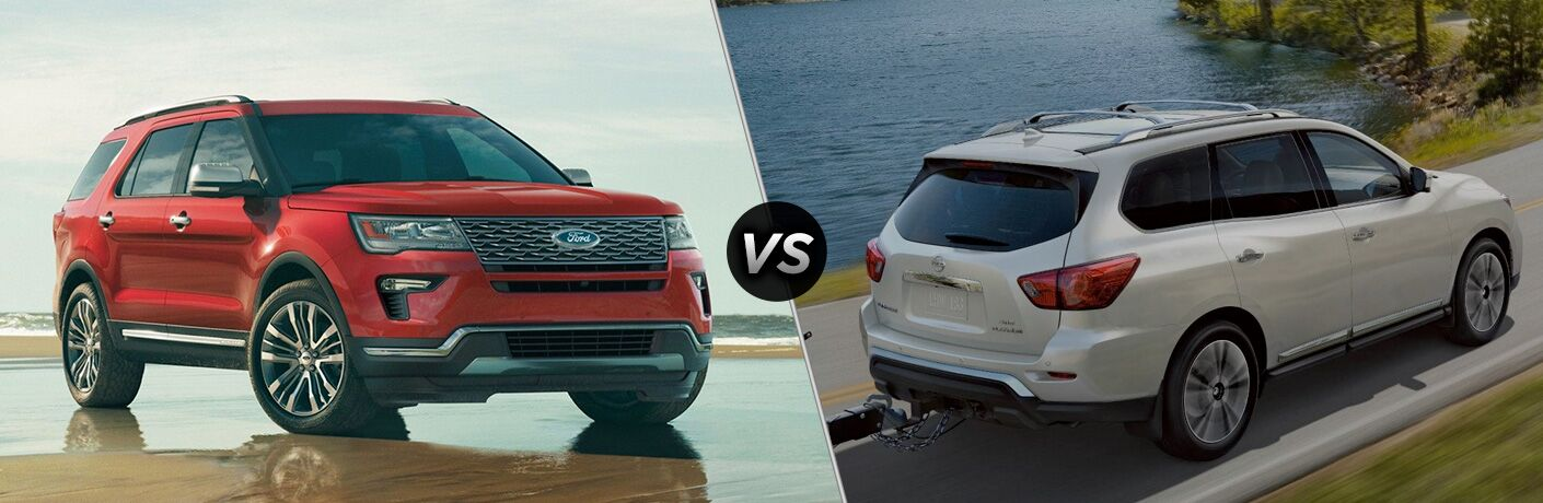 Red 2019 Ford Explorer, VS icon, and white 2019 Nissan Pathfinder