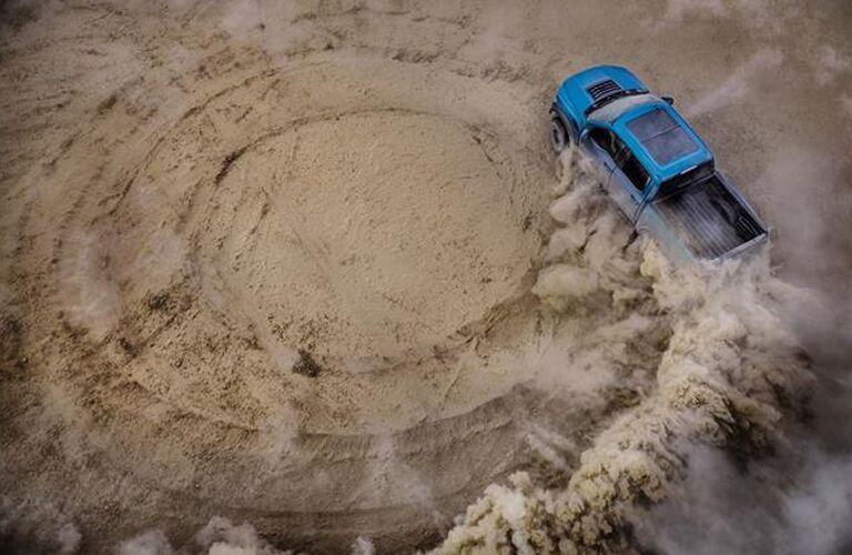 2019 Ford F-150 Raptor blue doing dusty doughnuts