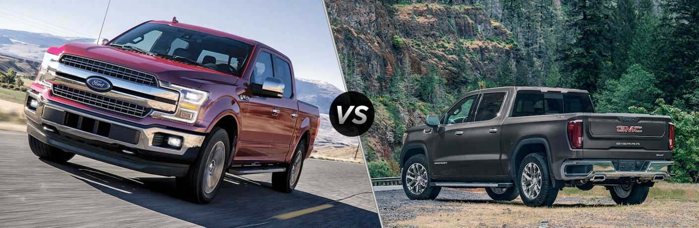 Red 2019 Ford F-150 on Country Highway vs Gray 2019 GMC Sierra 1500 Rear Exterior in the Mountains