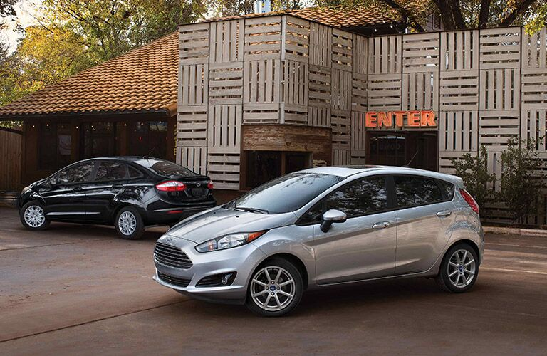 Black 2019 Ford Fiesta Sedan and Silver 2019 Ford Fiesta Hatchback Parked in a Driveway