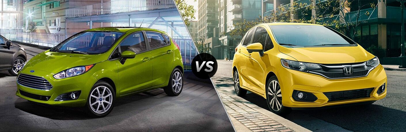 Green 2019 Ford Fiesta Hatchback in a Parking Structure vs Yellow 2019 Honda Fit on a City Street