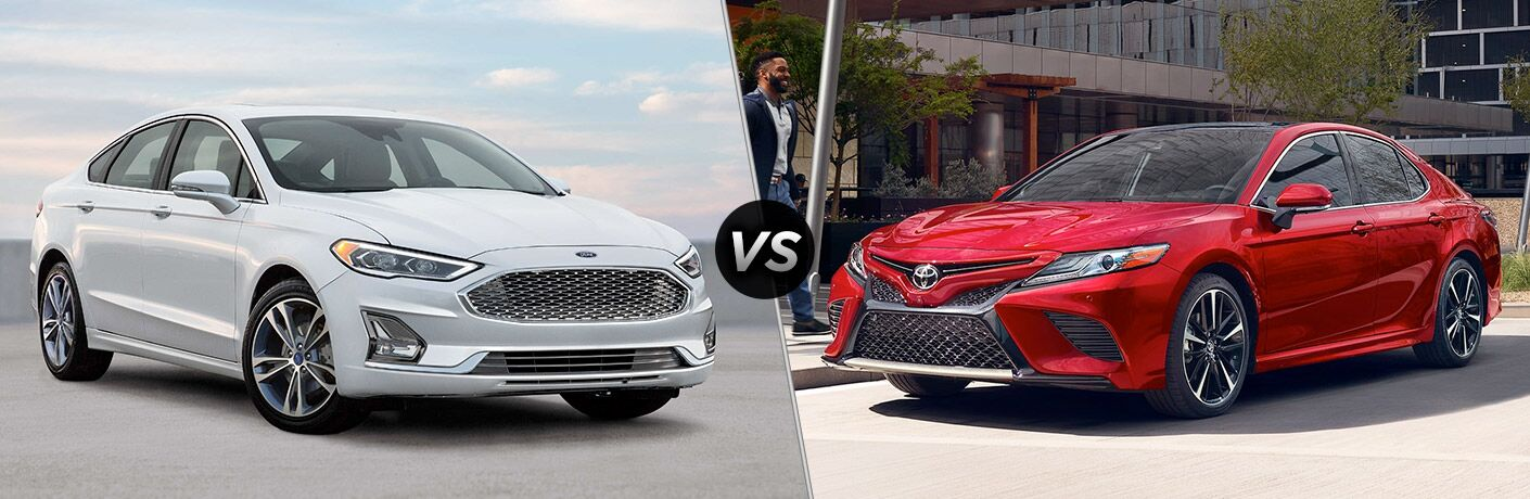 White 2019 Ford Fusion at the Beach vs Red 2019 Toyota Camry on a City Street