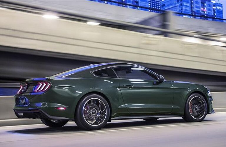Dark Highland Green 2019 Ford Mustang Bullitt Driving in a Tunnel