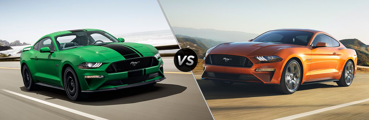 Green 2019 Ford Mustang with Black Racing Stripes on a Coast Road vs Orange 2018 Ford Mustang on a Highway
