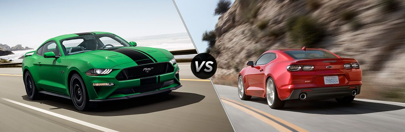 Green and Black 2019 Ford Mustang on a Coast Road vs Red 2019 Chevy Camaro Rear Exterior on a Country Road