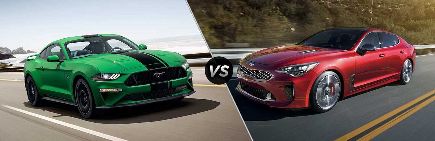 Green 2019 Ford Mustang with Black Racing Stripes on a Coast Road vs Red 2019 Kia Stinger on a Highway