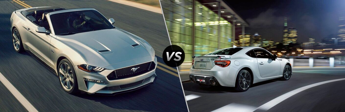Silver 2019 Ford Mustang Convertible on Highway vs White 2019 Subaru BRZ Rear Exterior on a City Street