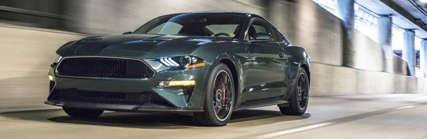 Dark Highland Green 2019 Ford Mustang Bullitt Driving in a Tunnel