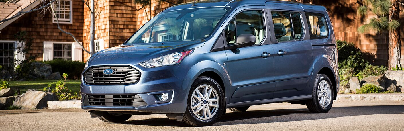 Blue 2019 Ford Transit Connect on Street