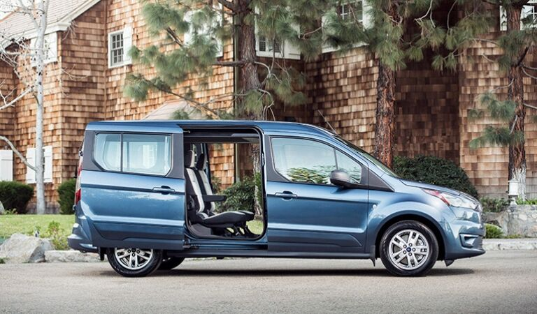 Blue 2019 Ford Transit Connect Wagon in a Driveway with Doors Open