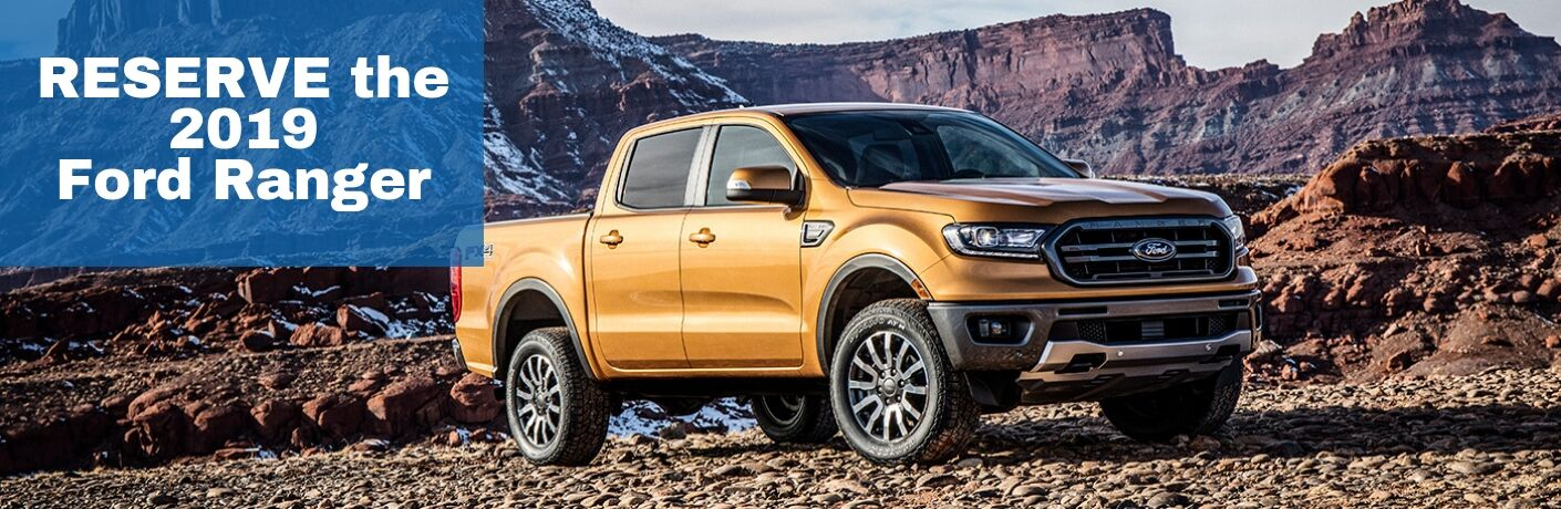 Orange 2019 Ford Ranger on Mountain Trail with Blue Box with White Reserve the 2019 Ford Ranger Text