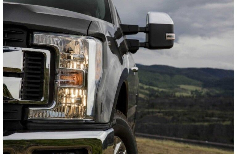 2018 Ford F-450 SuperDuty close up black grill hilly background