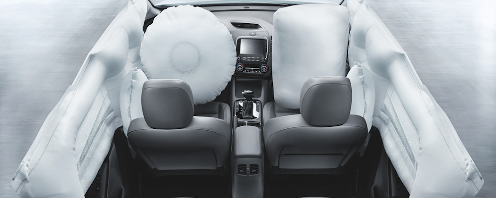 An airbag location display on the interior of the Kia Forte
