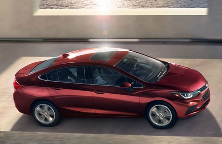 Red 2016 Chevy Cruze driving