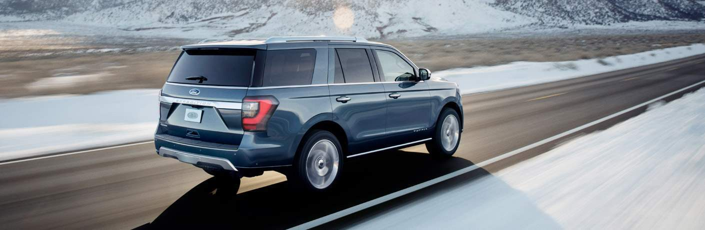 2018 Ford Expedition Rear View Driving Down a Snowy Mountain Road
