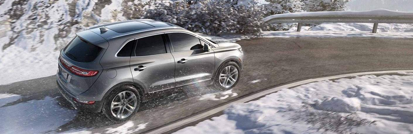 2018 Lincoln MKC Driving Through Snowy Mountain Road