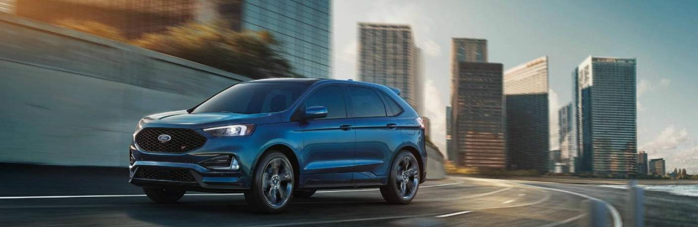 2019 Ford Edge Driving away From Tall Buildings