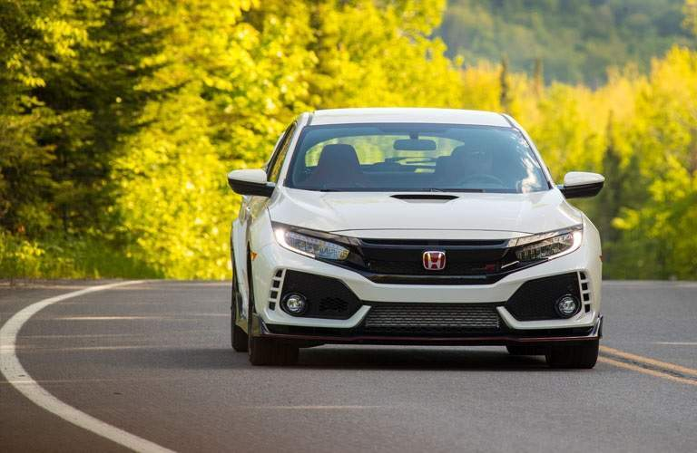 white 2017 Honda Civic Type R driving on open country road