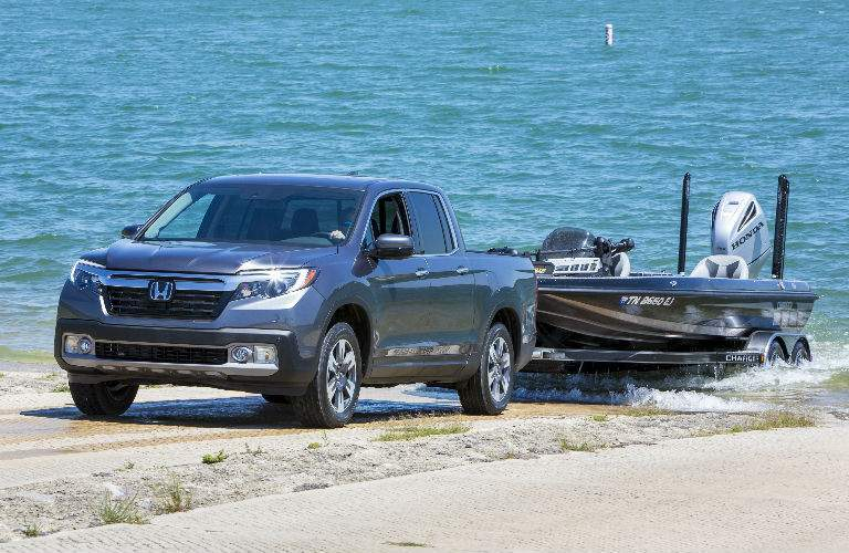 2018 Honda Ridgeline in Silver towing a boat