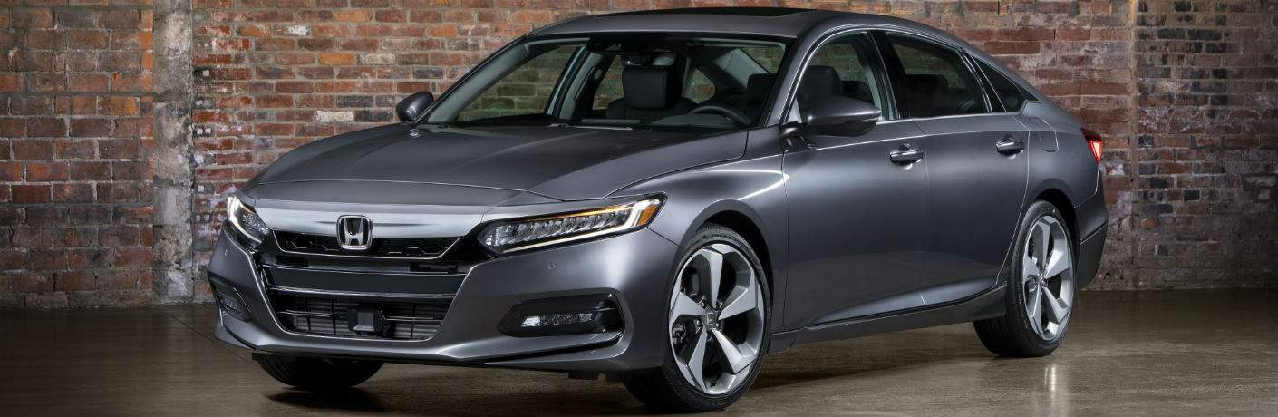 Front view of 2018 Honda Accord with gray exterior in front of a brick wall