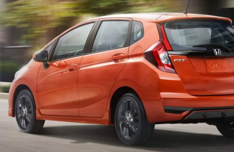 orange 2018 Honda Fit seen from the rear